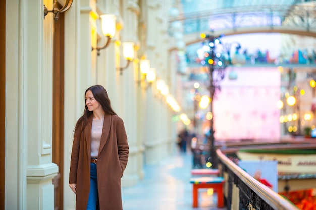 Beautiful woman on shopping in mall indoors