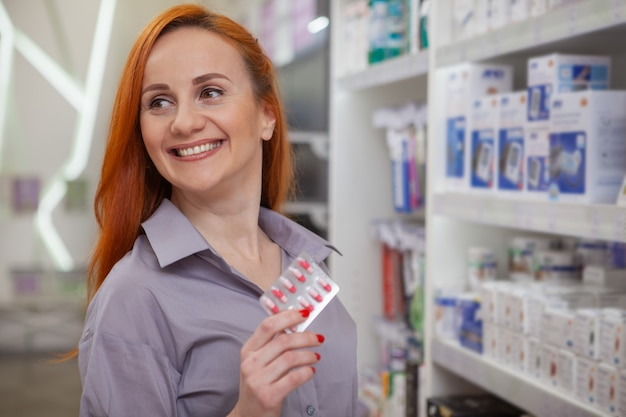 Beautiful woman shopping at the pharmacy