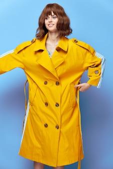 Beautiful woman short hair yellow coat attractive look