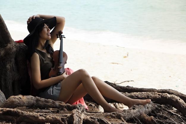 Beautiful woman sitting on the beach