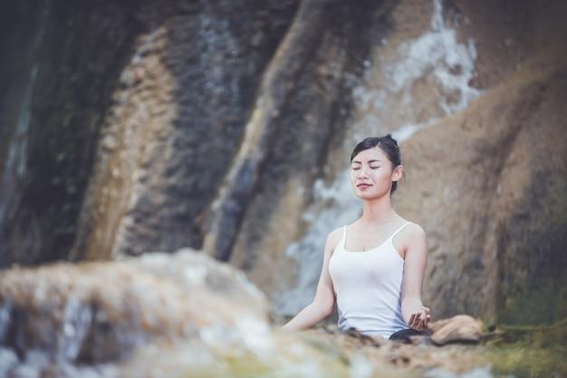 Beautiful woman sitting and practicing yoga.
