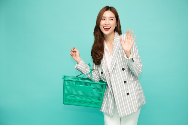 Beautiful woman smiling and holding shopping basket