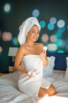 Beautiful woman smiling sitting in towel, good morning concept