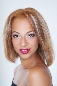 Beautiful woman smiling withttps://cdn-contributor.freepik.com/racool_studio/3949505/previews/626/d68i7228.jpgh red lips