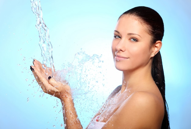 Beautiful woman under splash of water