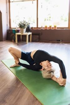 A beautiful woman in sportswear practicing yoga
