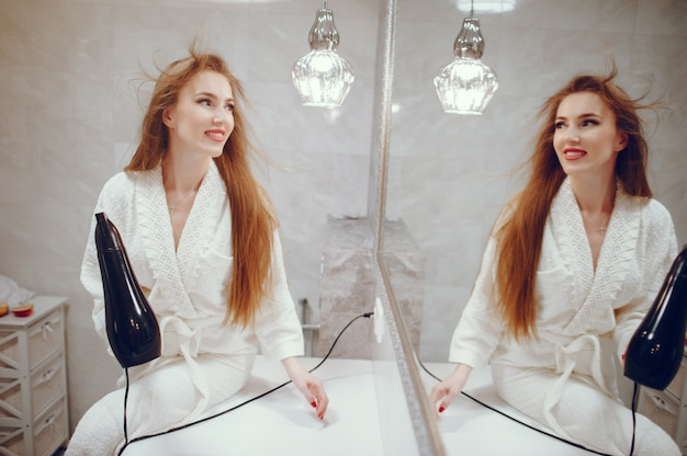 Beautiful woman standing in a bathroom