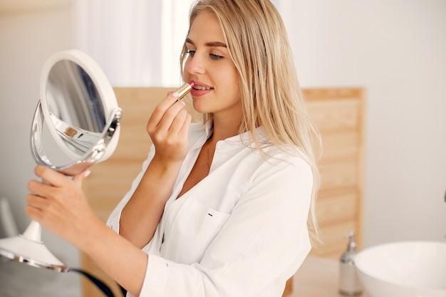 Beautiful woman standing in a bathroom