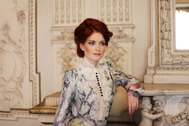 Beautiful woman standing in the palace room.
