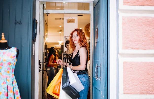 Beautiful woman standing in shop doorway