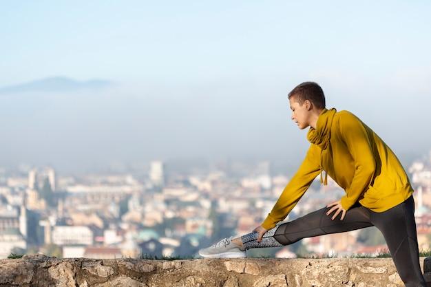 Beautiful woman stretching outdoors