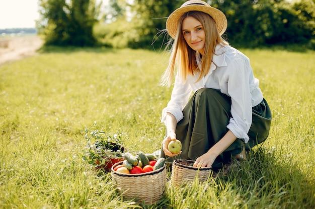 Beautiful woman in a summer field