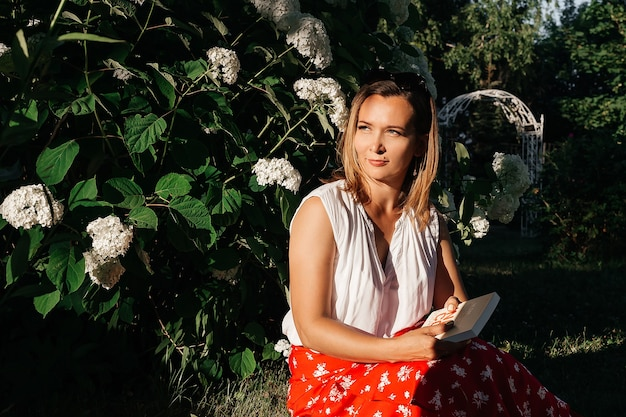 A beautiful woman in a summer park.