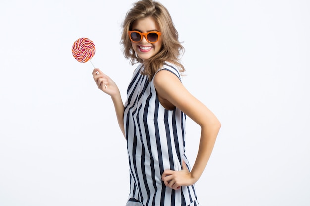 Beautiful woman in sunglasses and striped dress.