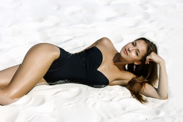 Beautiful woman in a swimsuit on the beach