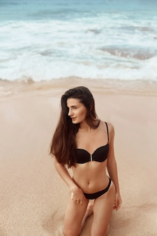 Beautiful woman in swimwear on the beach portrait of pretty female with slim tanned sexy body
