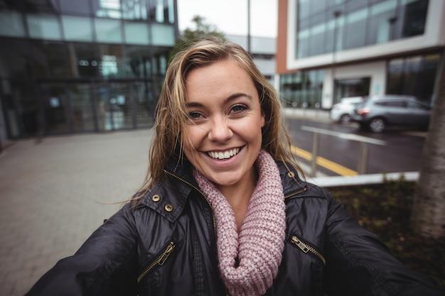 Beautiful woman taking a selfie on smartphone