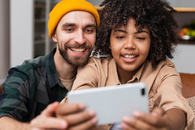 Beautiful woman taking selfies with her boyfriend