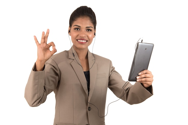 Beautiful woman talking in a video conference online by using smartphone and showing signs
