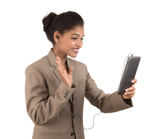 Beautiful woman talking in a video conference online by using smartphone
