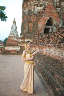 Beautiful woman in thai old traditional costume, portrait at the ancient ayutthaya temple
