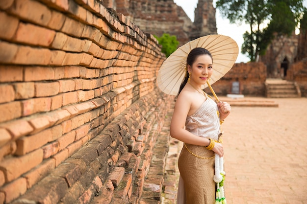 Beautiful woman in thai old traditional costume , portrait at the ancient ayutthaya temple.