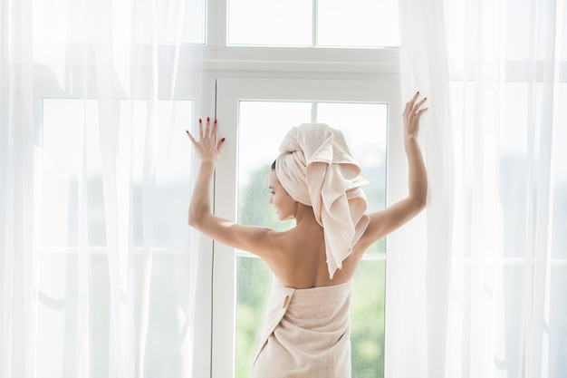 Beautiful woman in the towel after bathing
