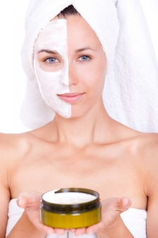 Beautiful woman in towel with facial mask
