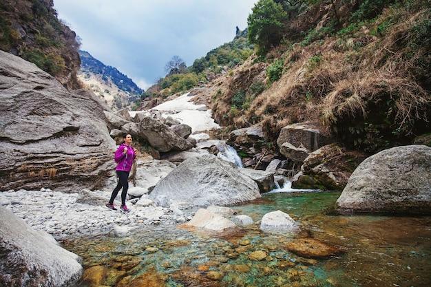 Beautiful woman trekking alone in indian himalayas