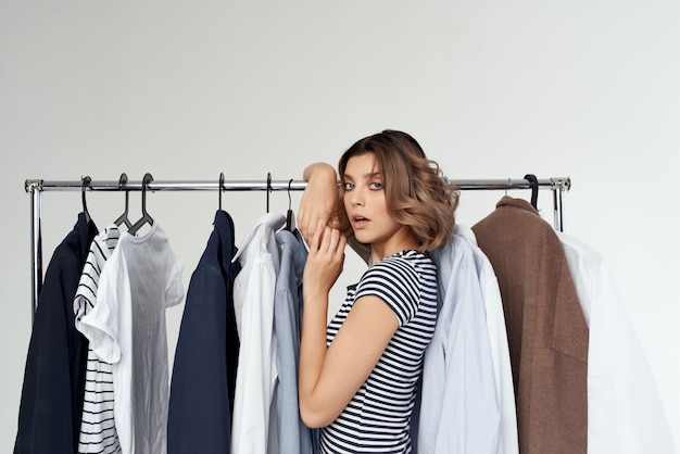 Beautiful woman trying on clothes shop retail isolated background