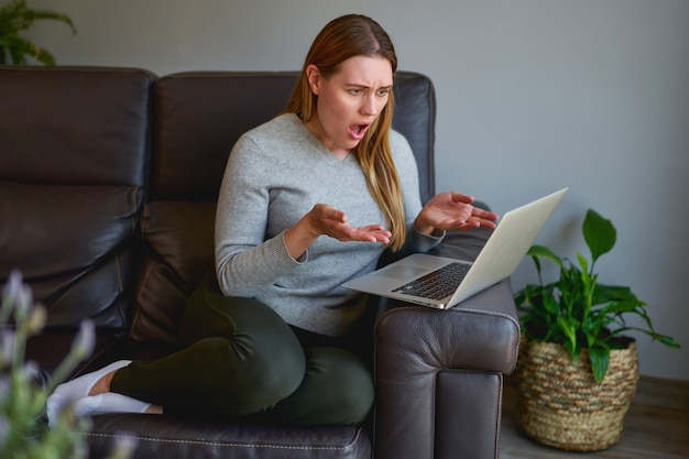 Beautiful woman using a laptop computer at home