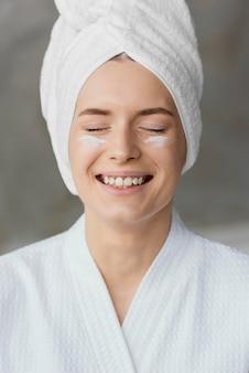 Beautiful woman using a skin care cream