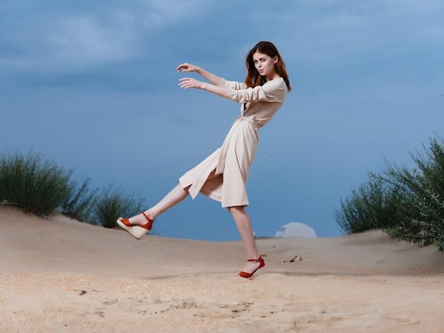 Beautiful woman walk along the beach sand tropics lifestyle fashion