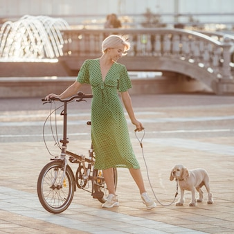 Beautiful woman walking her cute dog