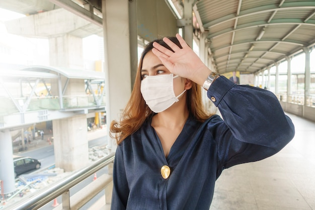 Beautiful woman wearing anti dust mask protect air pollution and pm 2.5 on street city