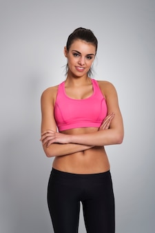 Beautiful woman wearing fashionable sport clothes