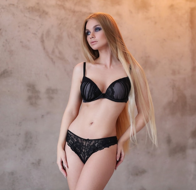 Beautiful woman wearing sexy black lingerie