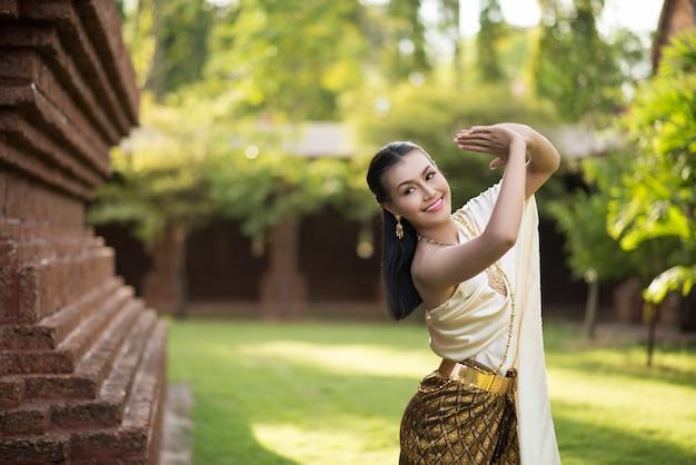 Beautiful woman wearing typical thai dress