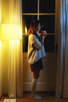 Beautiful woman wearing warm sweater and socks