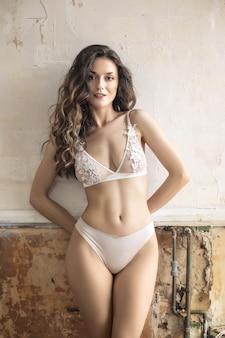 Beautiful woman wearing white elegant lingerie