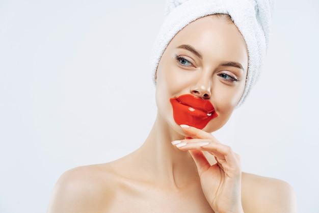 Beautiful woman wears lip patch
