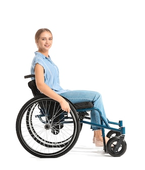 Beautiful woman in wheelchair on white