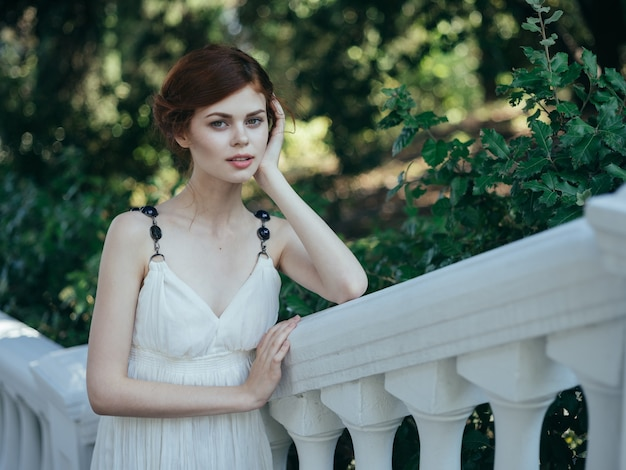 Beautiful woman in white dress classic style and luxury charm nature vacation
