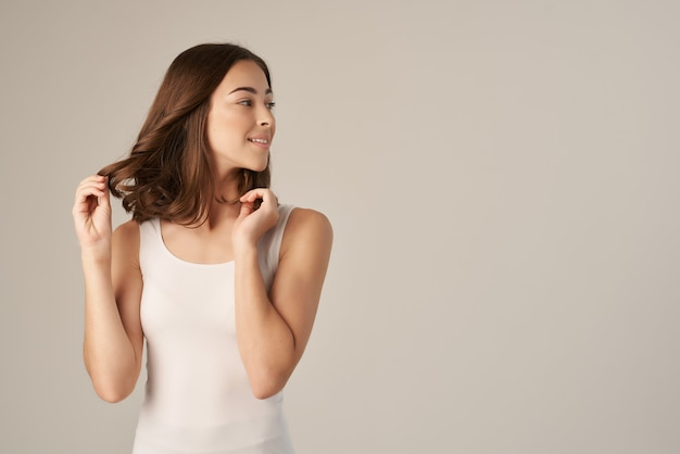 Beautiful woman in a white tshirt hair care isolated background