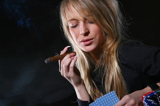 Beautiful woman who smoke cigar Free Photo