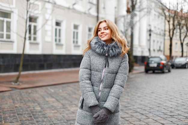 Beautiful woman in winter clothing on a background of the streets