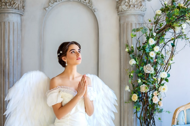 Beautiful woman with angel wings inspires beauty