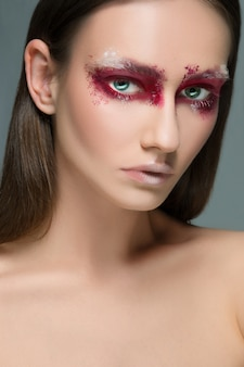 Beautiful woman with artistic make up