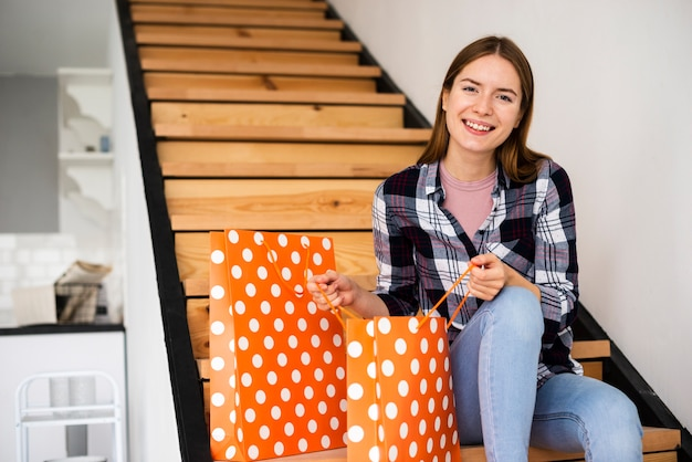Beautiful woman with bags and sitting