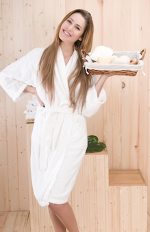 Beautiful woman with basket and spa treatment